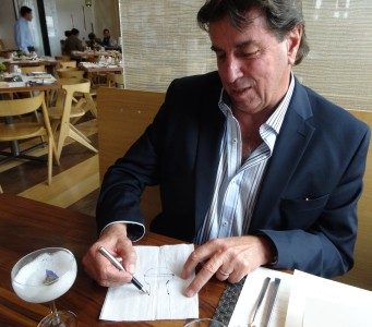 Johnny Schuler drawing a pisco glass