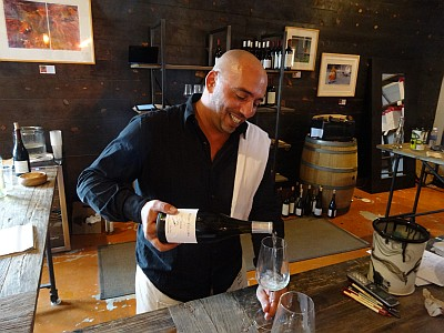 Vinny Lupo pouring wine