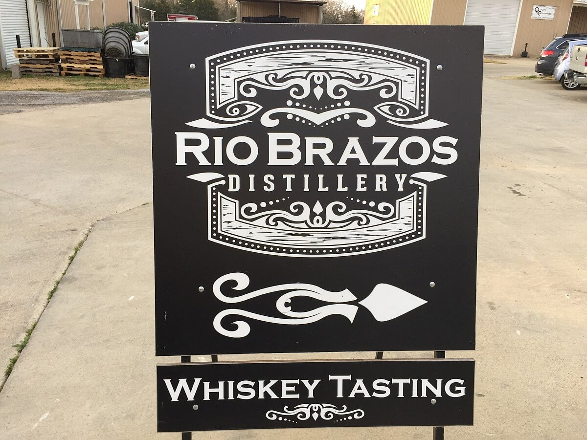 Rio Brazos Distillery sign