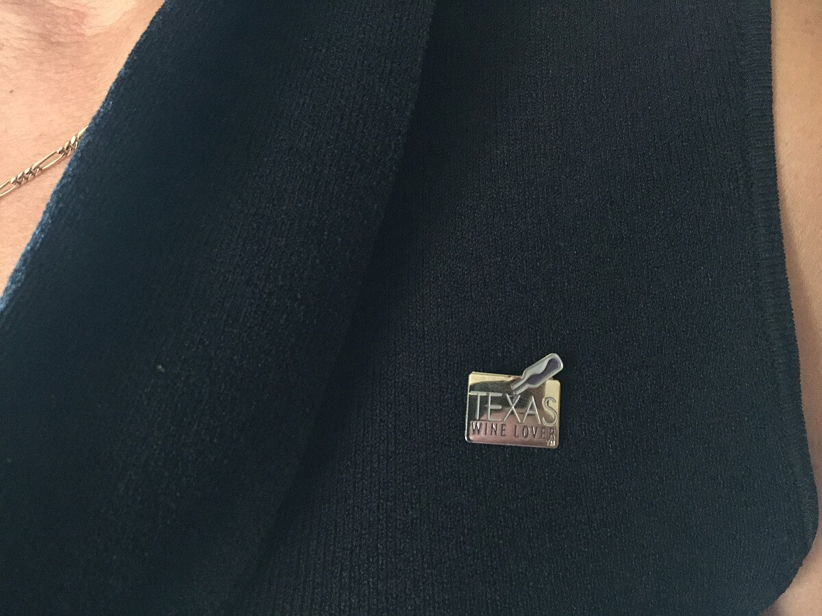 Texas Wine Lover pin on woman's blouse