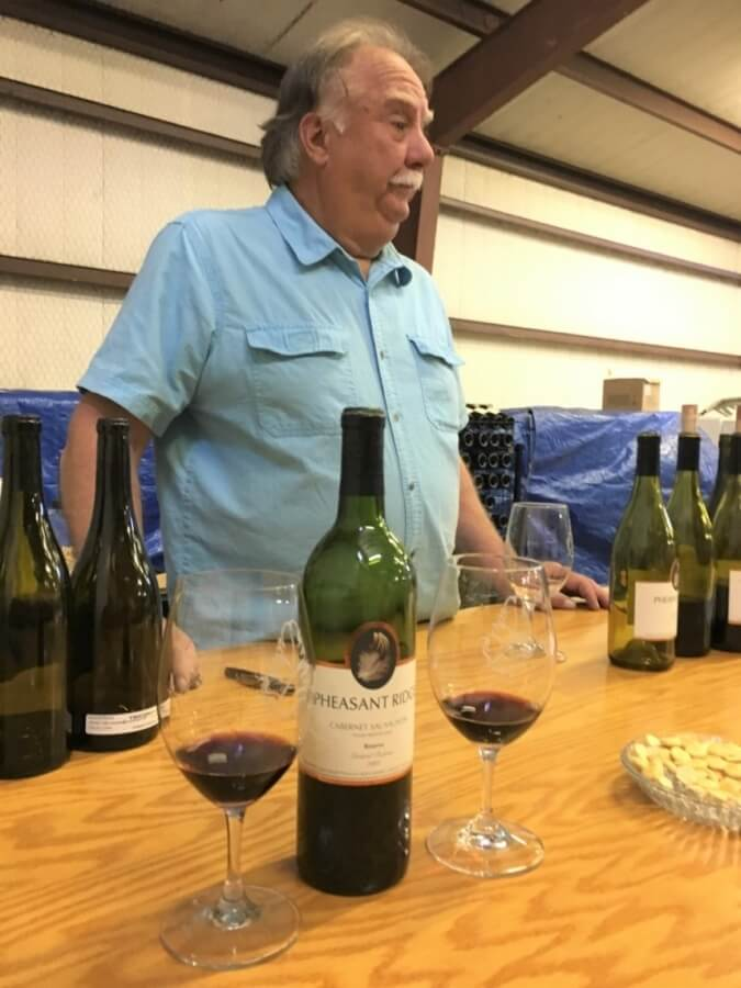 Proprietor Bobby Cox talking about Pheasant Ridge Cabernet Sauvignons on his tasting list