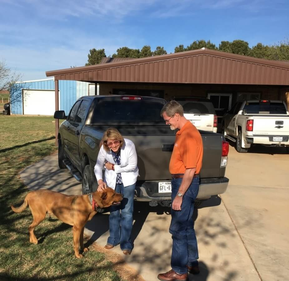 Laurie & Shelly Ware being greeted by Gay & Jet Wilmeth's dog, Picasso