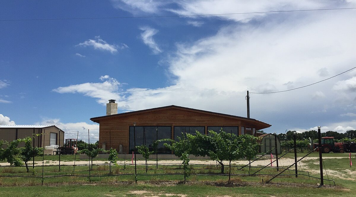 Arche's new parking lot with tasting room