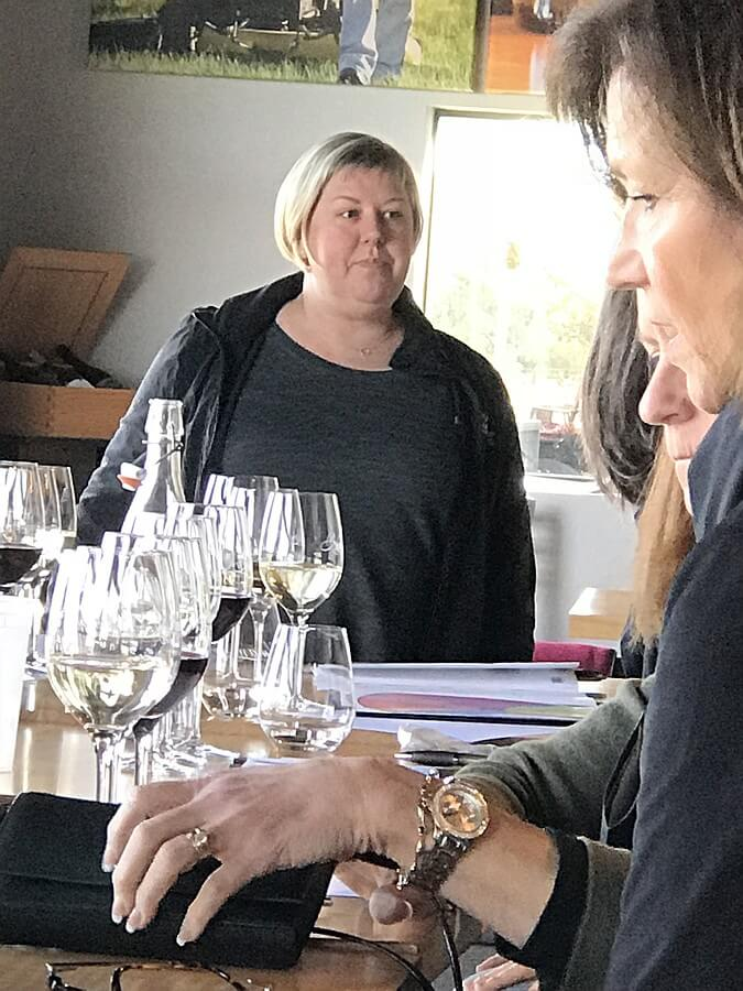 Kuhlman Cellars Marketing Director Jennifer Beckmann leading a Vina Vita University class on wine faults, flaws, and imbalances