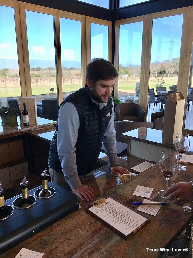 Tyler Turbeville hosting our wine tasting – notice the beautiful vineyard view behind the tasting room