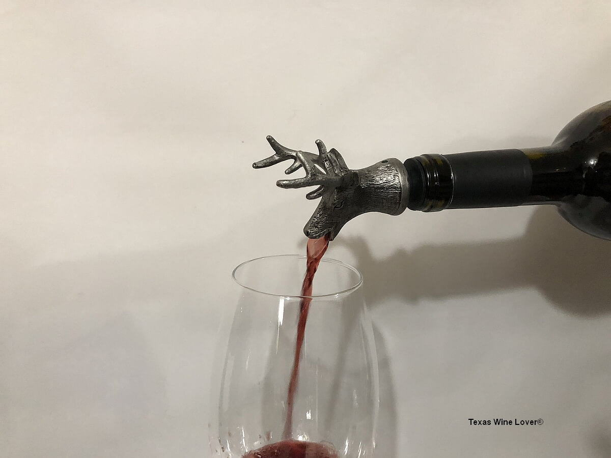Buck wine pourer in action