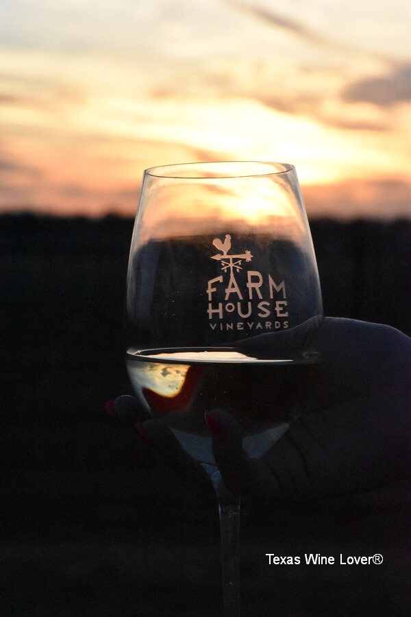 Farmhouse Vineyards glass in sunset