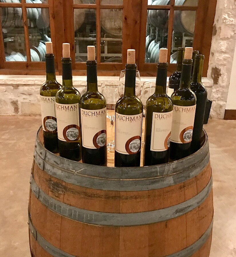 Bottles of Duchman Family Winery Aglianico, 2010-2018, opened and ready for the Retrospective Tasting