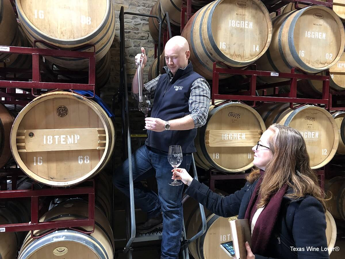 Seth Urbanek pouring from barrel