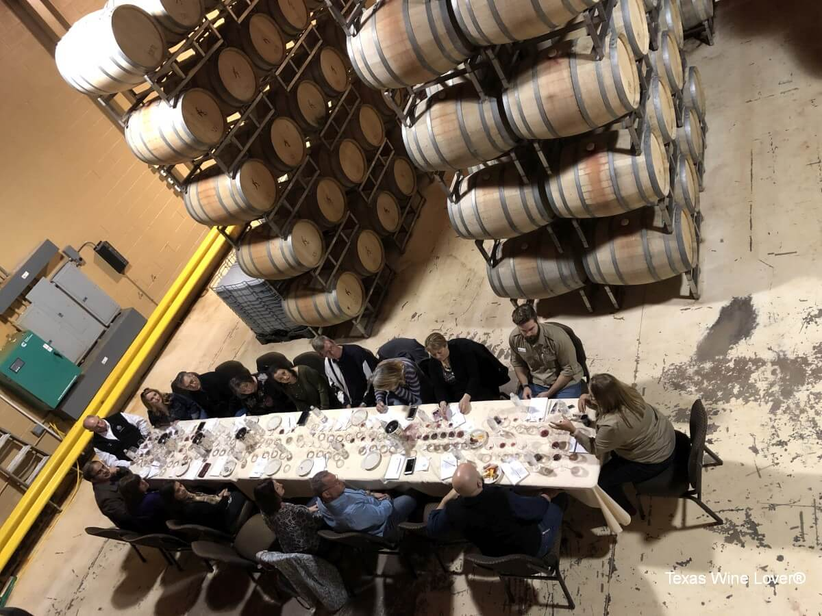 Tasting group in the barrel room