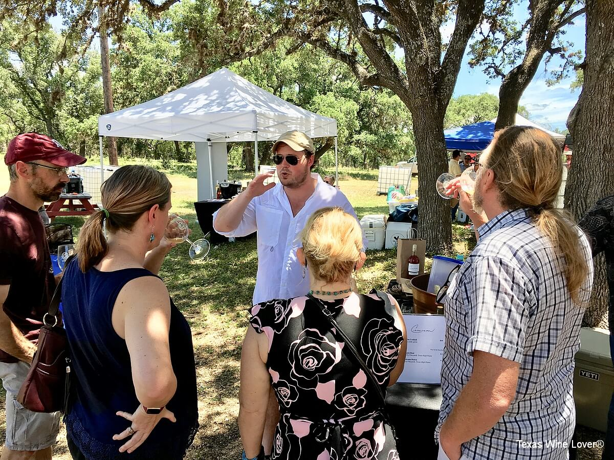 Henry Crowson entertaining festival attendees with stories and wine