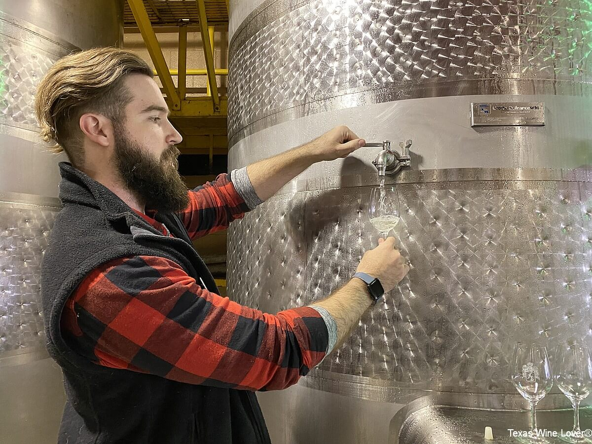 Alex Lee and tasting from the stainless tank
