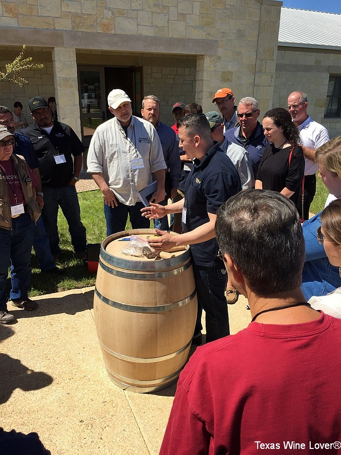 A Cooper demonstrating barrel maintenance techniques for a seminar presented at a Texas Hill Country Wineries Symposium.